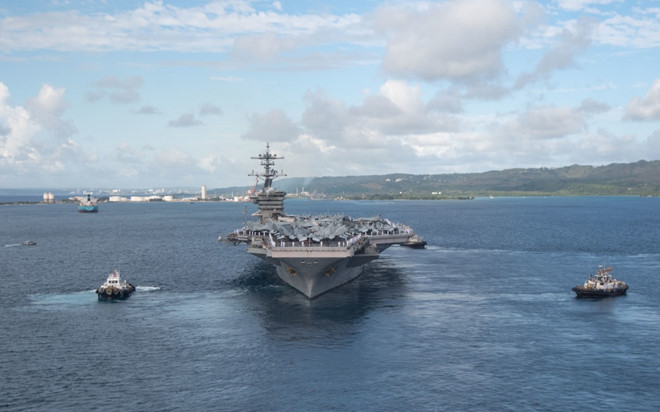 USS Theodore Roosevelt aircraft carrier leaves Apra port on Guam island